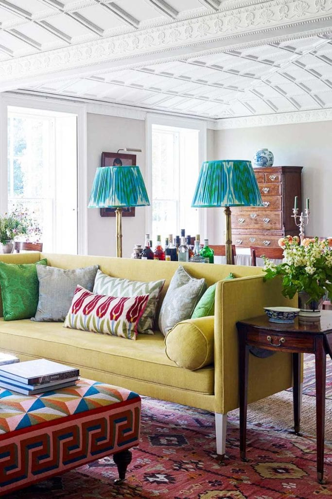 Colorful living room with teal patterned lampshades and yellow sofa on Thou Swell @thouswellblog