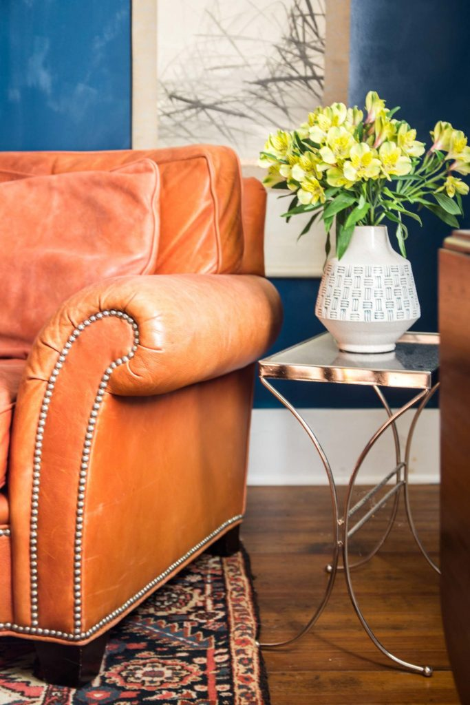 Red leather armchair in blue dining room on Thou Swell @thouswellblog