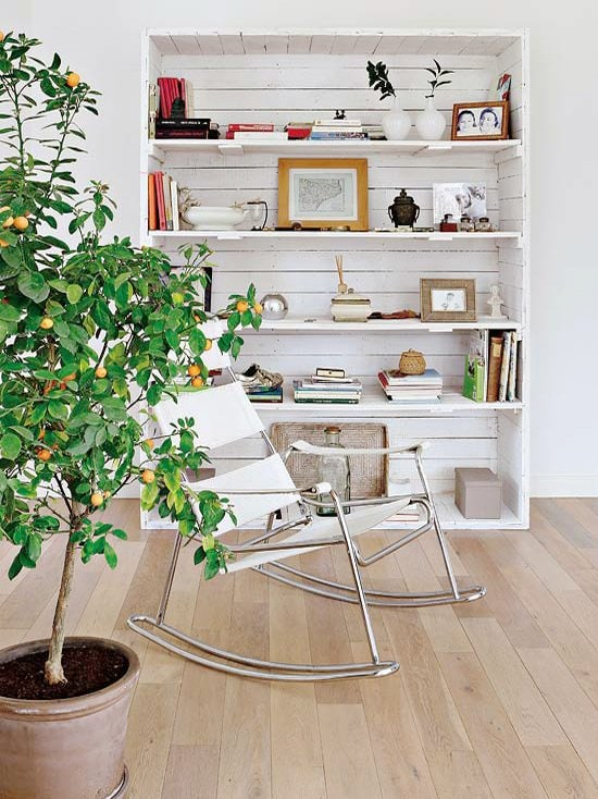Modern apartment in Madrid with large indoor citrus tree and Barcelona rocking chair, how to care for indoor citrus trees on Thou Swell @thouswellblog
