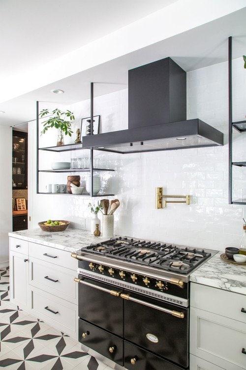 Modern white kitchen with black appliances on Thou Swell @thouswellblog