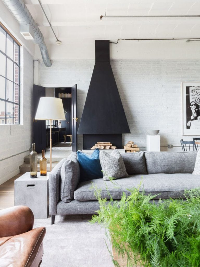 Modern urban loft with custom oversized chimney hood in living room on Thou Swell @thouswellblog