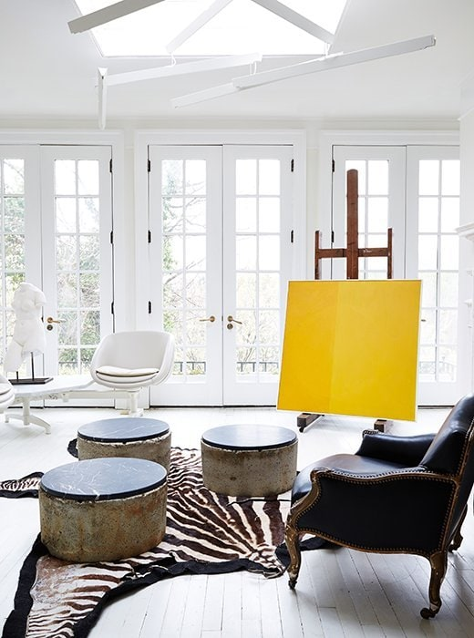 Stunning white sunroom with yellow painting and zebra rug on Thou Swell @thouswellblog