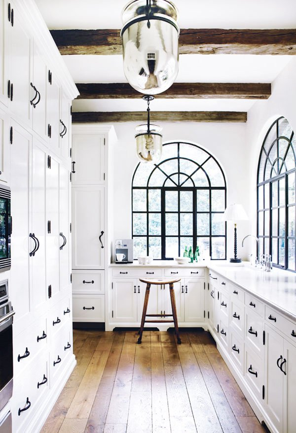 Beautiful black and white galley kitchen with arched iron windows and table l& in the corner  sc 1 st  Thou Swell & Why Your Kitchen Needs a Table Lamp - Thou Swell