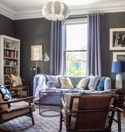 Gray and blue living room in Atlanta, GA with modern and vintage mix on Thou Swell #livingroom #livingroomdesign #greyroom #greylivingroom #greypaint #interiordesign #homedesign #homedecor #interior #design