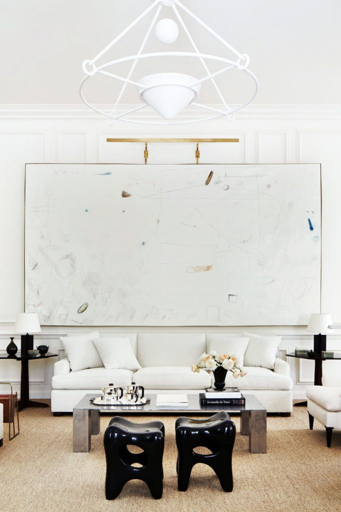 White living room with large painting and sisal rug on Thou Swell @thouswellblog