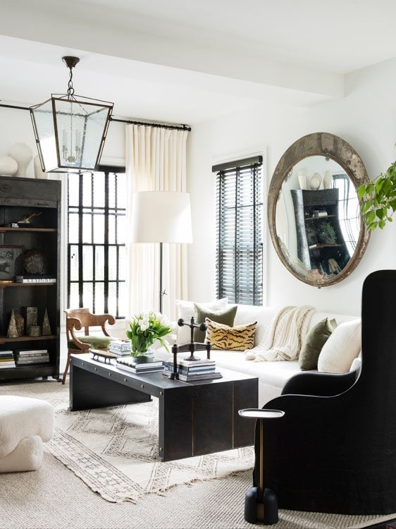 Ryan Hughes home in Midtown Atlanta, black and white living room with mirror and lantern #livingroom #livingroomdesign #atlantahome #atlantahomes