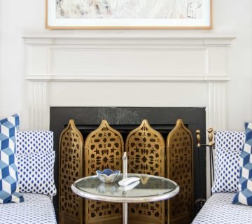 Navy dot slipper chairs in white living room with Moroccan fireplace screen on Thou Swell #livingroom #livingroomdesign #fireplacedesign
