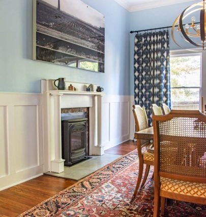 Light blue dining room (Behr Rain Dance) with white flat panel wainscoting (Behr Sleek White) before and after makeover by Kevin O'Gara on Thou Swell #diningroom #diningroomdesign #diningroommakeover #beforeandafter #diypaneling #diymoulding #bluepaint #painting #wainscoting