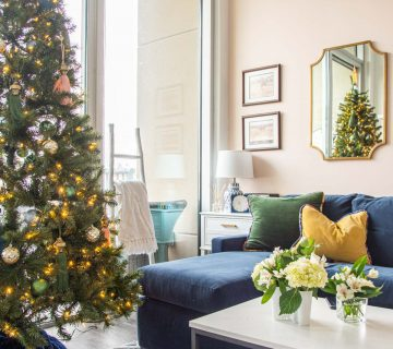 Jewel-tone Christmas tree holiday decor with tassels and boho style from SmithHönig in apartment living room by Kevin O'Gara on Thou Swell #christmas #christmastree #christmasdecor #holidaydecor #bohodecor #bohochristmas #tassels #smithhonig #apartment #apartmentdecor #livingroomdesign