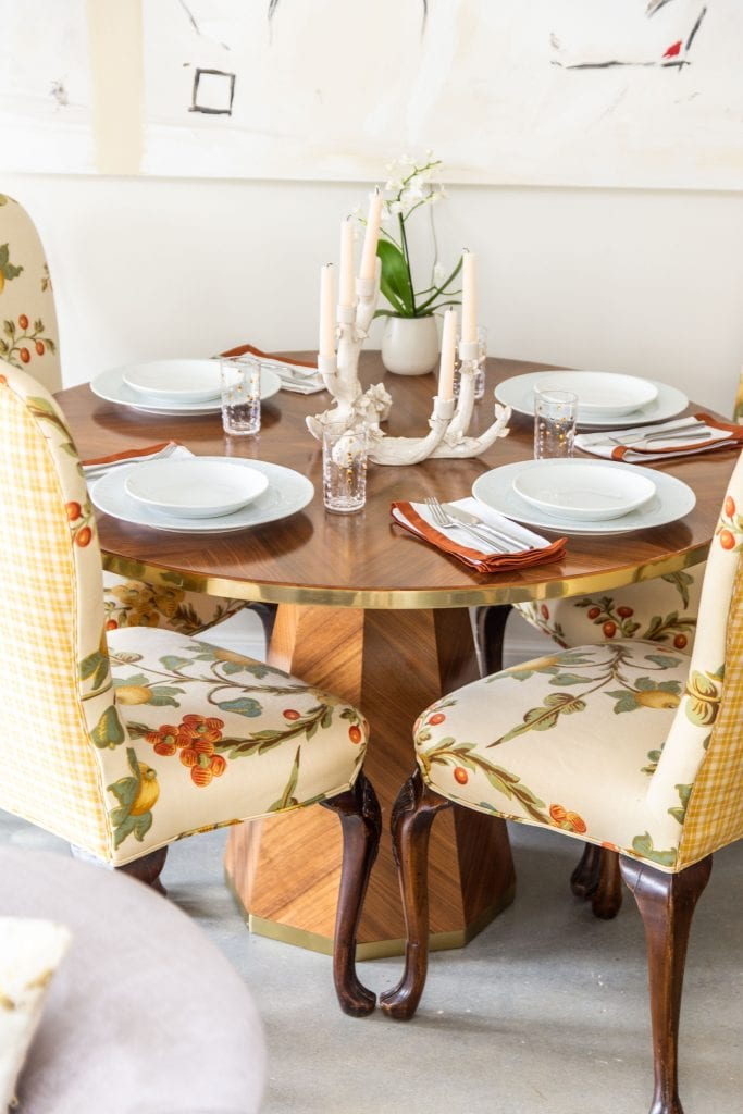Round marquetry dining table from Anthropologie outlet in Georgia in apartment entryway with abstract painting and floral dining chairs by Kevin O'Gara on Thou Swell #entryway #diningtable #roundtable #marquetry #anthropologie #homedecor #interiordesign