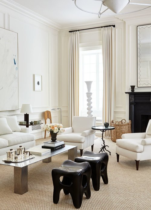 White living room design with layers of cream, tan, and black in New York townhouse with tall ceilings by Alyssa Kapito on Thou Swell #livingroom #livingroomdesign #interiordesign #oneroomchallenge #homedecor #homedecortips #livingroomgoals