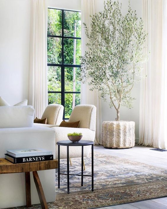 Living room by Studio Lifestyle, neutral home decor inspiration on Thou Swell #livingroom #homedecor #homedecorinspiration #decor #decorating #interiordesign