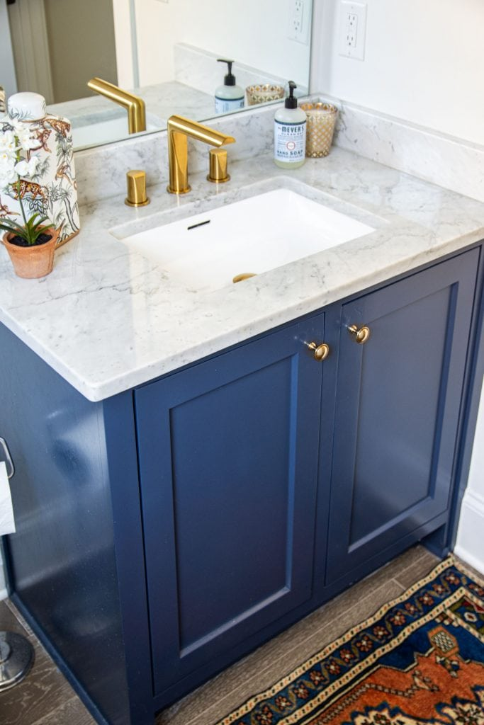 Riobel brushed gold Parabola faucet by House of Rohl in powder room bathroom design on Thou Swell #bathroom #powderroom #powderbath #bathroomdesign #goldfaucet #sinkfaucet #homedesign #bathroomideas #renovation #houseofrohl