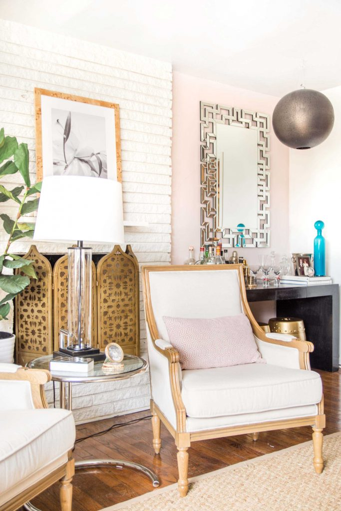 Behr Stolen Kiss, a soft and light blush pink paint color in a living room by Kevin O'Gara #blushpink #pinkwalls #pinkpaint #blushpaint #behrpaint #stolenkiss #behrstolenkiss #paintingideas #pinkpaintcolors #interiordesign