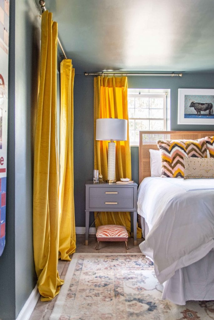 Dark green bedroom with home decor from AllModern, colorful bedroom design, dark bedroom, dark green wall color, yellow curtains #bedroomdesign #bedroomdecor #bedroominspo #greenpaint #greenroom #darkgreen #colorfulbedroom #homedecorideas #homedesign #bedroomideas