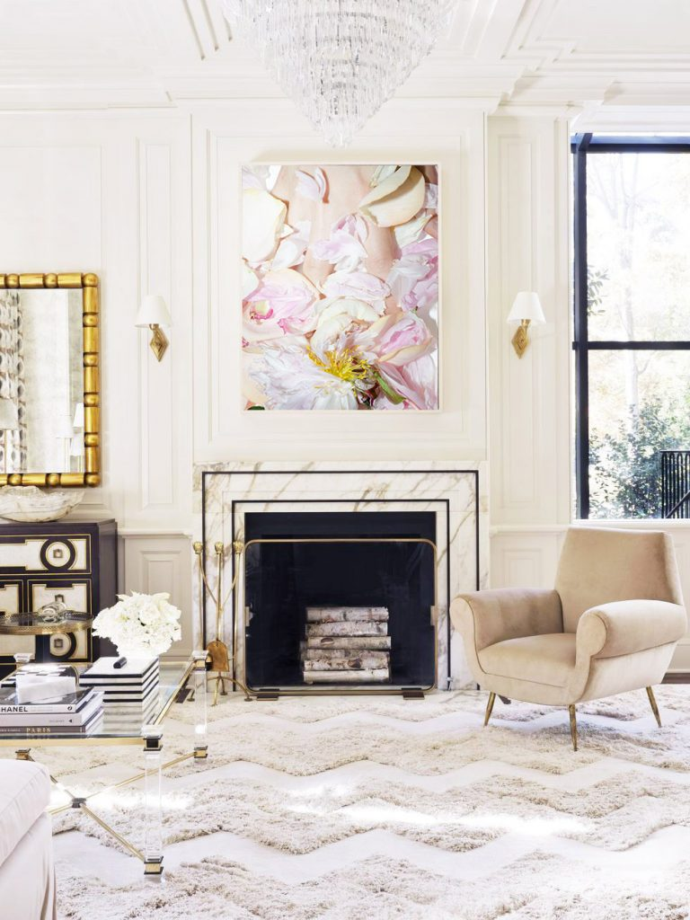 Flower photography art print above marble fireplace in cream living room design by Melanie Turner on Thou Swell #livingroom #livingroomdesign #artprint #flowers