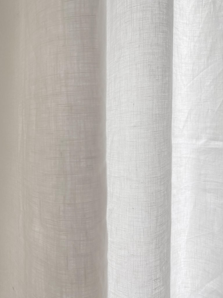 Custom tall sheer white linen curtains for two-story window living room on Thou Swell #curtains #drapery #linen #livingroom #livingroomdesign #livingroomdecor #homedecorideas