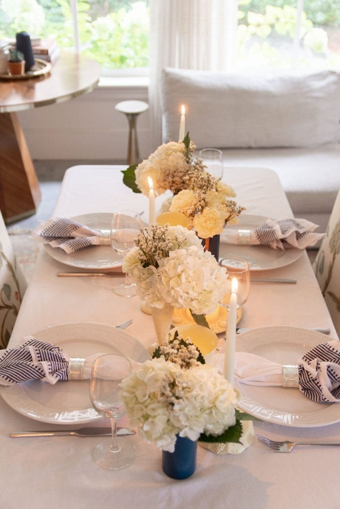Glowy candlelit summer table setting with Phoenician Yellow PlastiDip peelable spray paint DIY project on Thou Swell #diy #diyproject #plastidip #spraypaint #yellowpaint #tablesetting #tablescape #dinnerparty