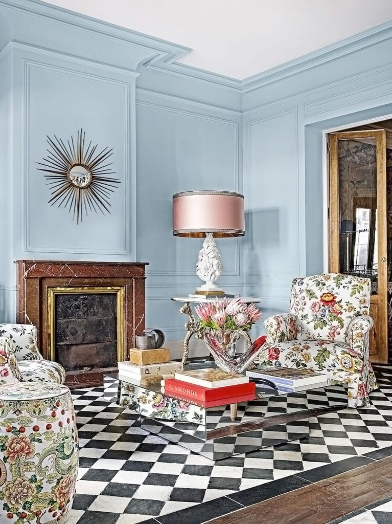 An exuberant blue living room in Spain by designer Jorge Vasquez, shop the look on Thou Swell #livingroom #livingroomdesign #spain #madrid #interiordesign #livingroomdesign #homedesign #homedecor